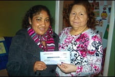 Pay It Forward recipients hold check