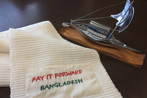 Pay It Forward Bangladesh scarf and statuette